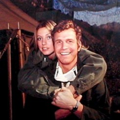 Color CBS promotional image for MASH featuring Karen Philipp and Wayne Rogers