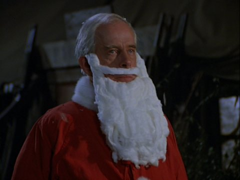 Image of Colonel Potter dressed up as Santa Claus