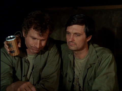 Still from the M*A*S*H episode Ceasefire showing Trapper and Hawkeye.