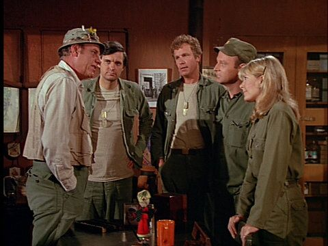 Still from the M*A*S*H episode Mad Dogs and Servicemen showing Henry, Hawkeye, Trapper, Frank, and Margaret