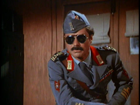 Colonel Flagg wearing an outrageous military uniform