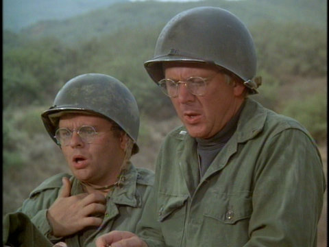 Still from the M*A*S*H episode Mulcahy's War showing Radar and Father Mulcahy