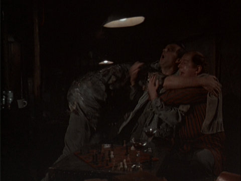 Still from the M*A*S*H episode Temporary Duty showing Charles and B.J. hugging Hawkeye
