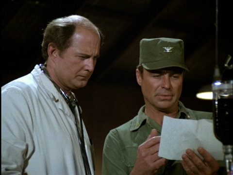 Still from the M*A*S*H episode Rally Round the Flagg, Boys showing Charles and Colonel Flag.