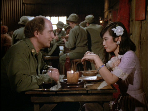 Still from the M*A*S*H episode Ain't Love Grand showing Charles and Sooni.