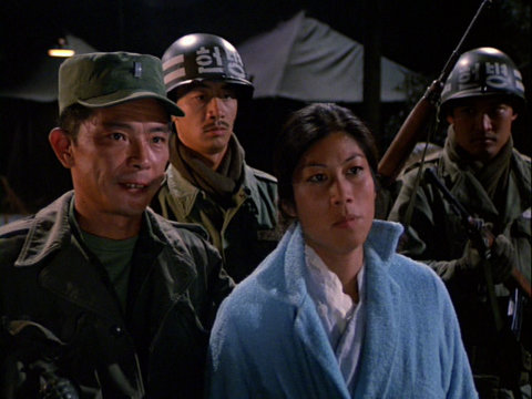 Still from the M*A*S*H episode Guerilla My Dreams showing Lt. Park and his prisoner