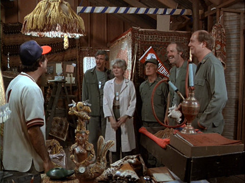 Still from the M*A*S*H episode Goodbye, Cruel World showing Klinger and others