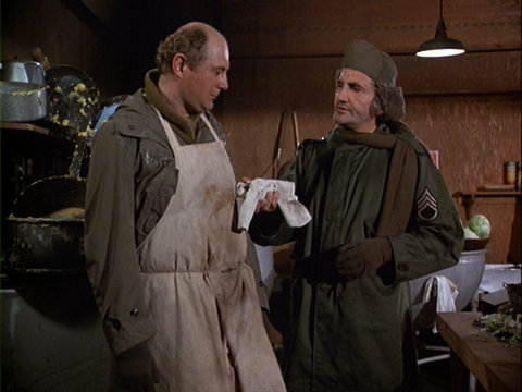 Still from the M*A*S*H episode 'Twas the Day After Christmas showing Charles and Sgt. Pernelli