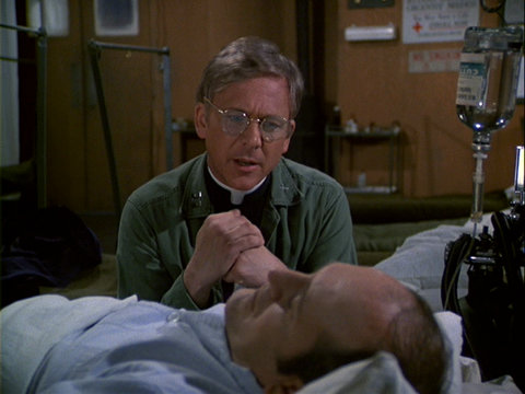 Still from the M*A*S*H episode Heroes showing Father Mulcahy
