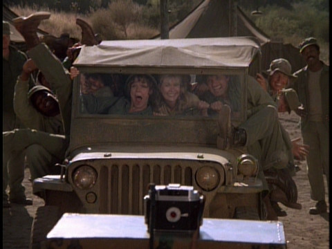 Members of the 4077th crammed into a jeep