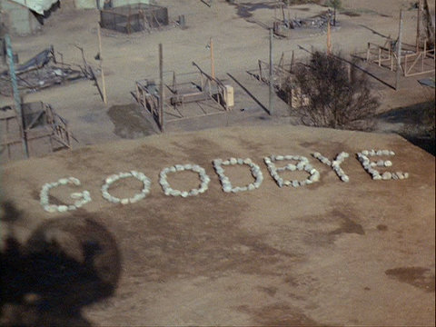 Still from the MASH episode Goodbye, Farewell and Amen showing GOODBYE written in stones.
