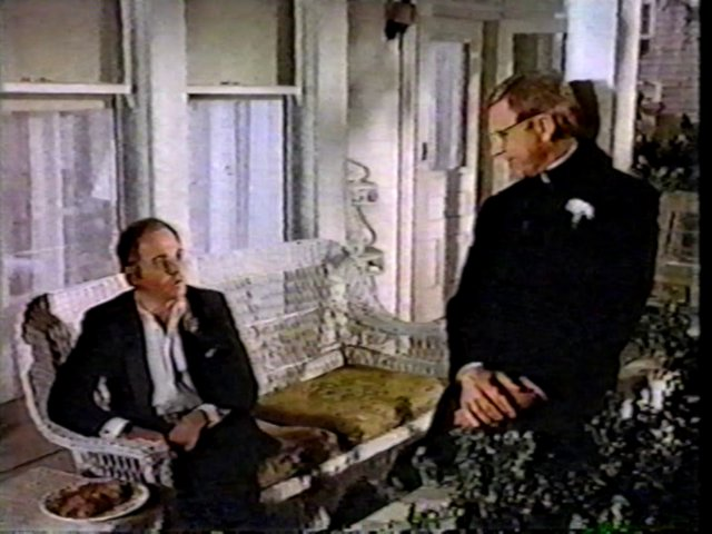 Still from the AfterMASH episode It Had To Be You showing Radar and Father Mulcahy.
