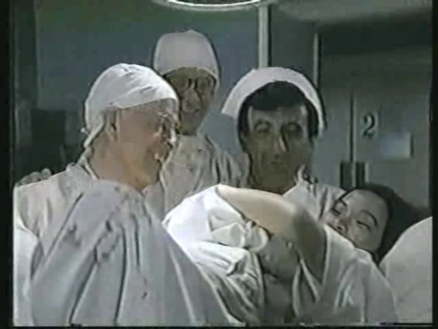 Still from the AfterMASH episode Less Miserable showing Potter, Father Mulcahy, Klinger, and Soon-Lee.