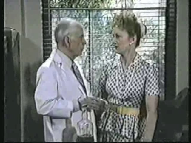 Still from the AfterMASH episode Strangers and Other Lovers showing Potter and Alma Cox.