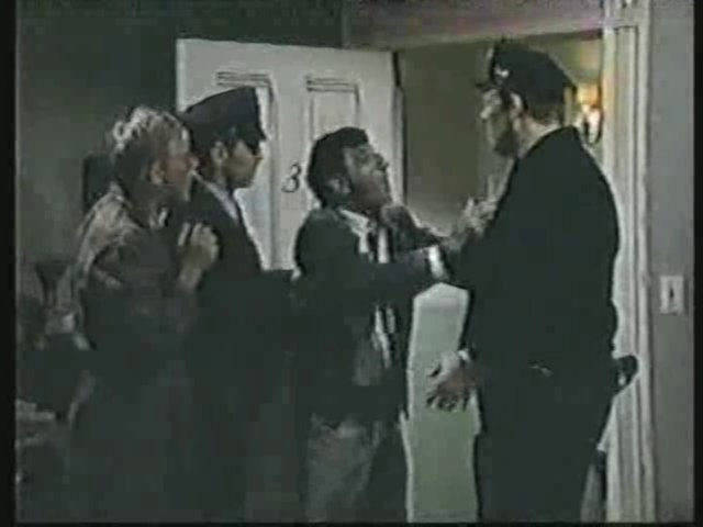 Still from the AfterMASH episode Strangers and Other Lovers showing Father Mulcahy and Klinger.