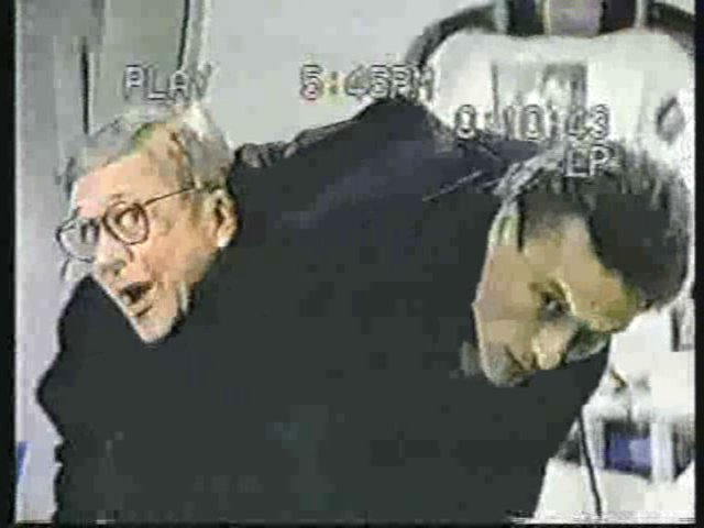Still from the AfterMASH episode Ward Is Hell showing Father Mulcahy and Dr. Boyer.