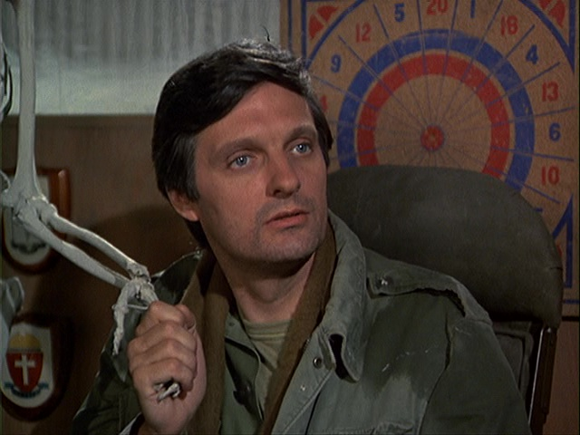 Still from the M*A*S*H episode Divided We Stand showing Hawkeye.