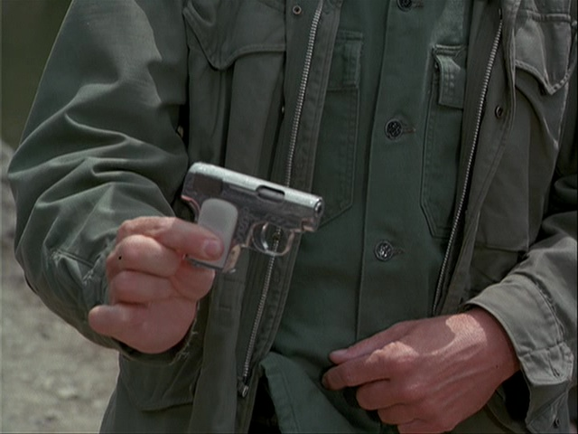 Still from the M*A*S*H episode Rainbow Bridge showing Frank's tiny gun.