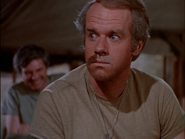 Still from the M*A*S*H episode The Joker is Wild showing B.J.