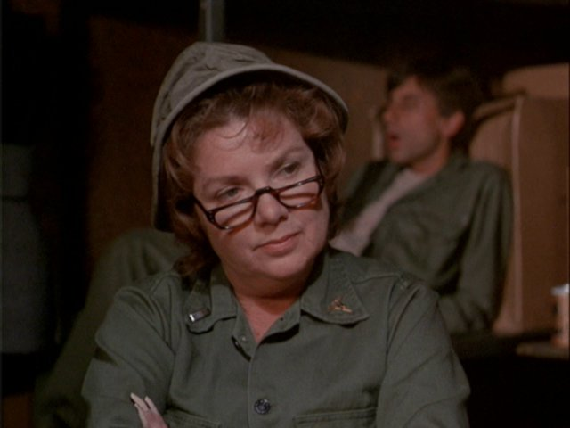 Still from the M*A*S*H episode Payday showing Pat Gelbart (credited as Pat Marshall) playing Lt. Nelson.
