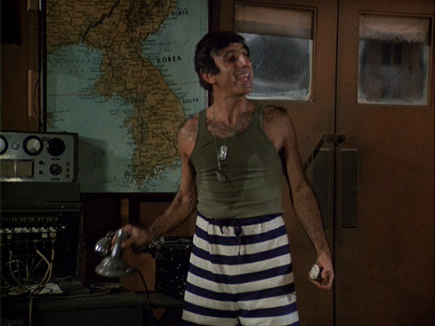 Still from the MASH episode No Sweat showing Klinger standing next to the radio/PA system.
