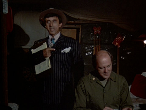 Still from an episode of M*A*S*H showing Klinger wearing a zoot suit.