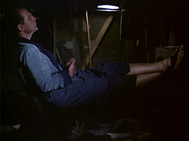 Still from the MASH episode Fade Out, Fade In showing Charles listening to music.