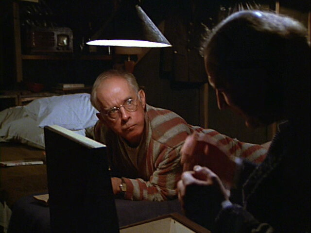 Still from the M*A*S*H episode Heal Thyself showing Charles listening to music.