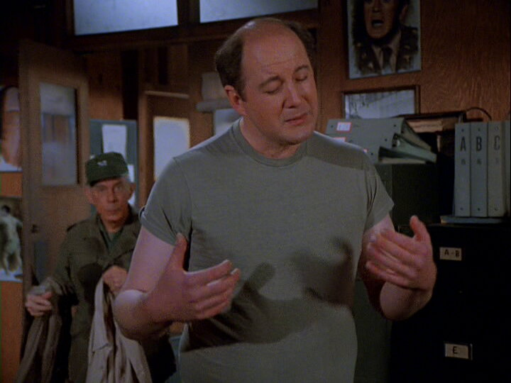 Still from the M*A*S*H episode Tell It to the Marines showing Charles listening to music.