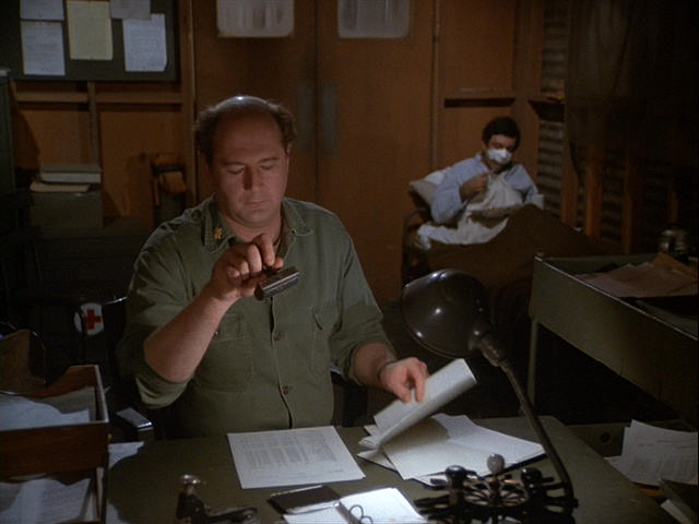 Still from the M*A*S*H episode Operation Friendship showing Charles humming Verdi.