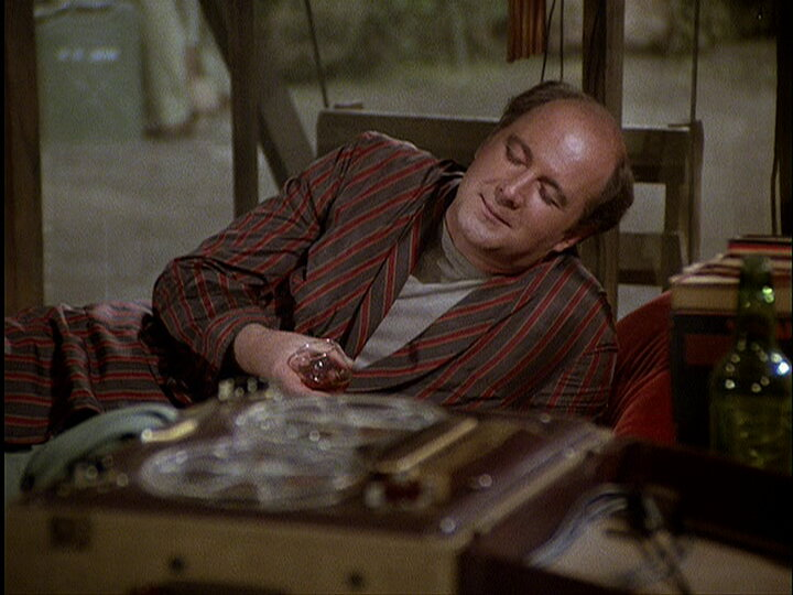 Still from the M*A*S*H episode The Foresight Saga showing Charles listening to music.