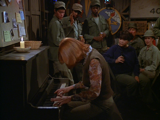 Still from the M*A*S*H episode That's Show Biz showing Ellie playing Beethoven.
