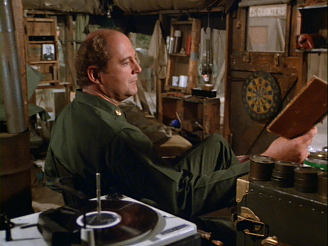 Still from the M*A*S*H episode The Birthday Girls showing Charles listening to music.