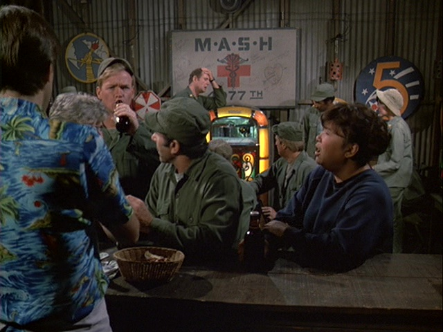 Still from the M*A*S*H episode Friends and Enemies showing Charles trying to listen to music.