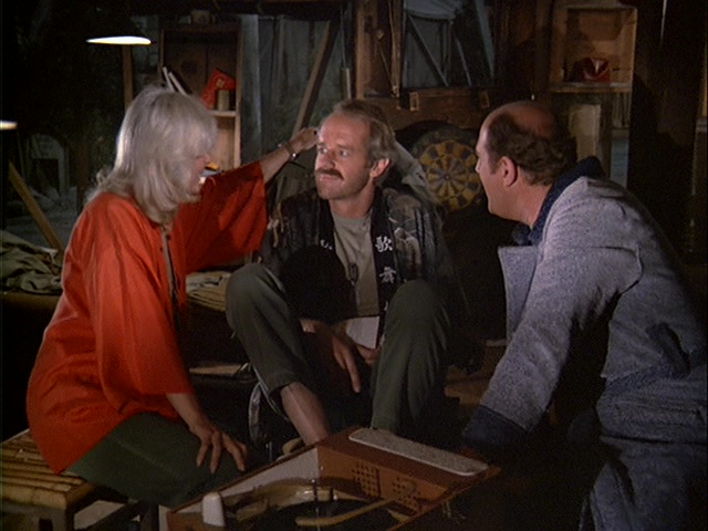 Still from the M*A*S*H episode Friends and Enemies showing Charles listening to music.
