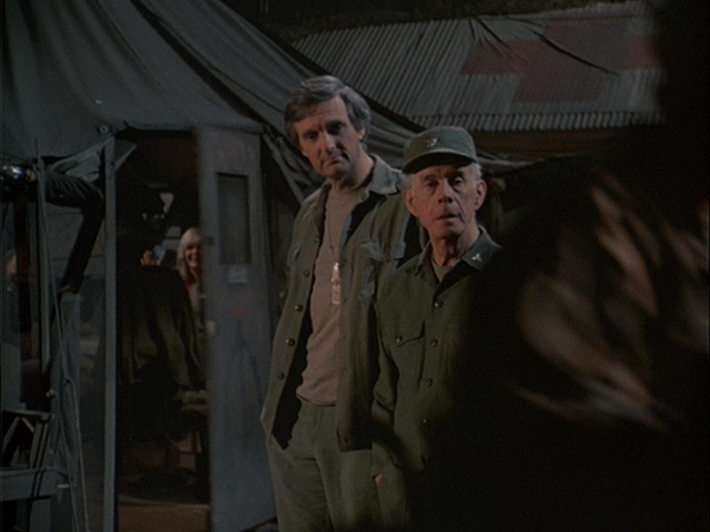 Still from the M*A*S*H episode Friends and Enemies showing Charles and Margaret listening to music.