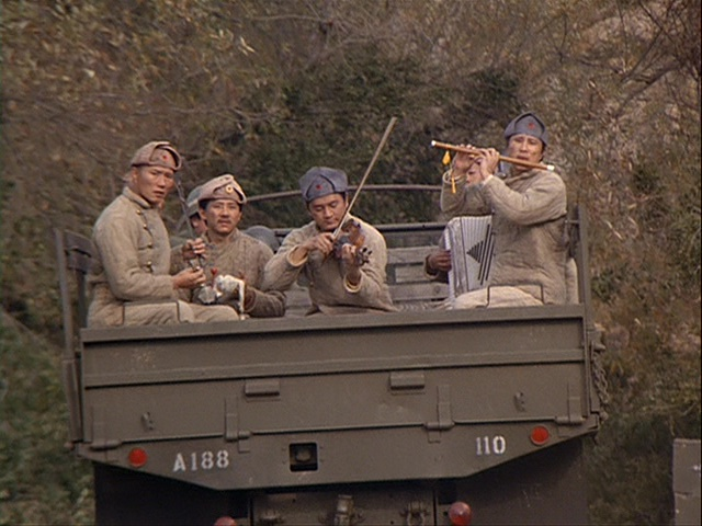 Still from the M*A*S*H episode Goodbye Farewell and Amen showing POWs playing Mozart.