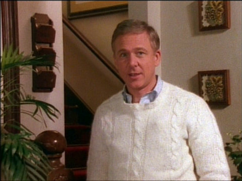 Image of William Christopher in a white sweater introducing the episode Dear Sis.