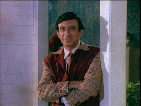 Image of Jamie Farr introducing the episode Officer of the Day.