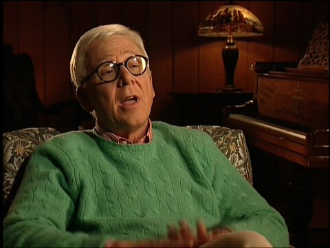 Image from the M*A*S*H 30th Anniversary Reunion Special showing William Christopher.